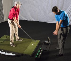 Student improvement- coach and student golf lesson